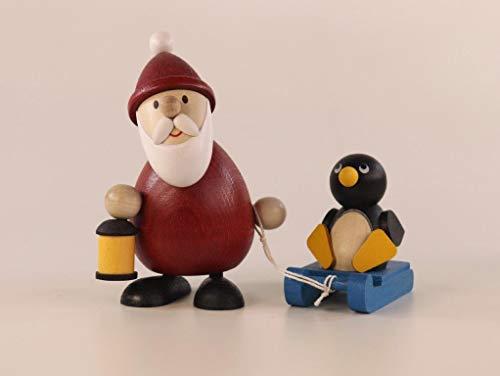 Ulrich Kunsthandwerk Weihnachtsfigur Weihnachtsmann mit Schlitten und Pinguin Höhe 9,5cm NEU...