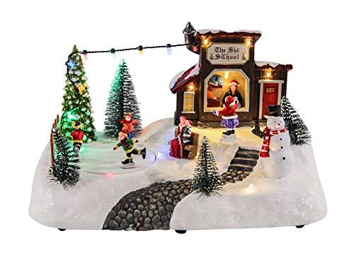 LED Weihnachts Szene Eisbahn mit fahrenden Figuren - 26x18x14 cm - Winter Dorf Tisch Deko beleuchtet